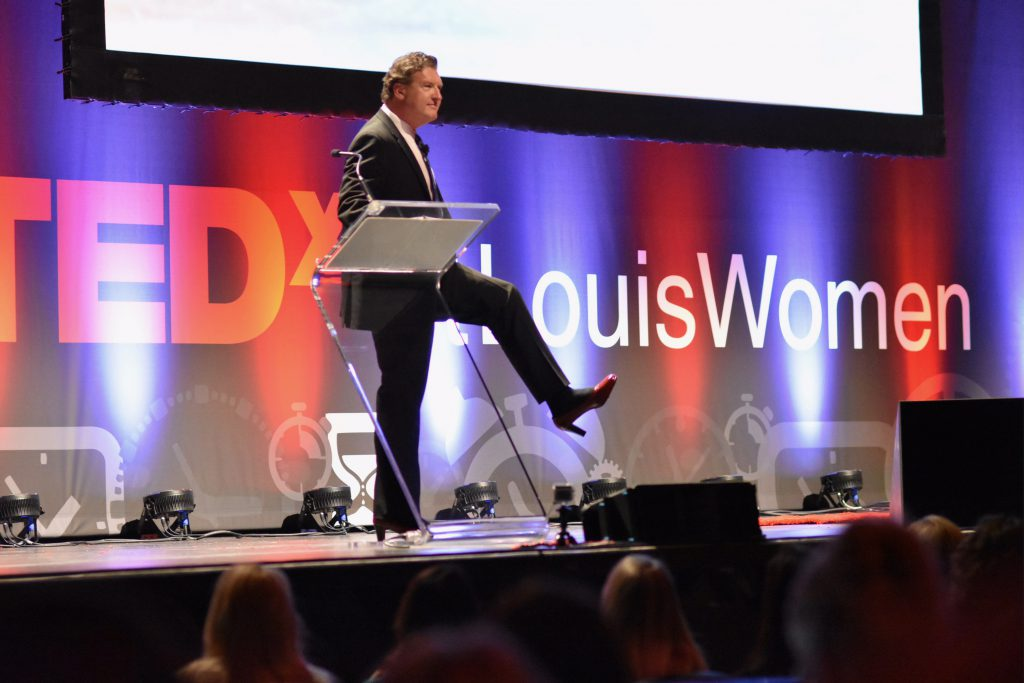 Jeffery Tobias Halter giving TEDx Talk in red pumps
